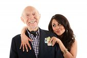 stock photo of hottie  - Rich elderly man with Hispanic gold - JPG