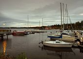 picture of burlington  - sailboats are moored in the harbor of burlington vermont at the end of a cool cloudy day - JPG