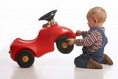 foto of bobbies  - baby boy lifts up his toy car - JPG