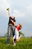 Father and daughter catching the ball