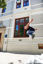 stock photo of parkour  - Man doing parkour in the city on a sunny day - JPG