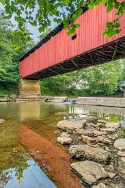 picture of yesteryear  - Built in 1878 The Harra Covered Bridge crosses the South Branch of Wolf Creek in rural Washington County Ohio - JPG