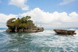 pic of tanah  - famous Tanah Lot Temple on Sea in Bali Island Indonesia with blue sky and waves  - JPG