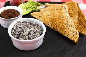 picture of canard  - Mushroom pate on a slate plate with pickle - JPG