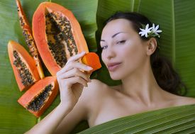 picture of papaya fruit  - Beautiful caucasian woman with fresh fruit papaya  - JPG