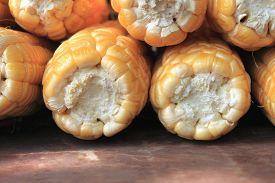 foto of corn cob close-up  - ripe corn on brown background close up - JPG