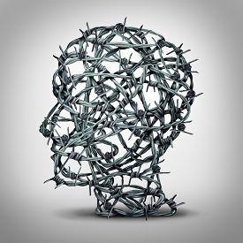 picture of torture  - Tortured thinking and depression concept as a group of tangled barbwire or barbed wire fence shaped as a human head as a metaphor for psychological or psychiatric condition of suffering and victim of oppression or mental illness - JPG