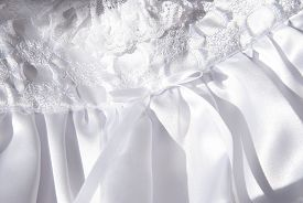 stock photo of baptism  - This is a close up of a white baptism dress laying down - JPG