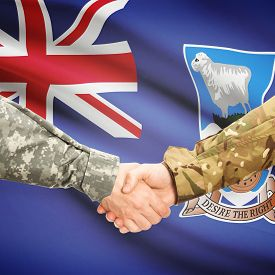 picture of falklands  - Soldiers shaking hands with flag on background  - JPG