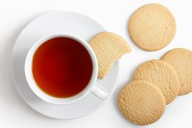 pic of shortbread  - White cup of tea and saucer with shortbread biscuits from above - JPG