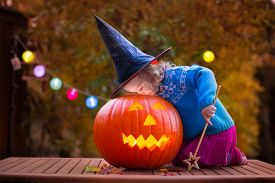 picture of carving  - Little girl and boy carving pumpkin at Halloween - JPG