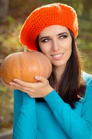 image of beret  - Young girl with crocheted orange beret and pumpkin - JPG