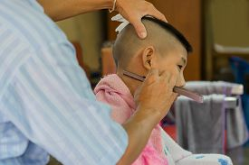 image of shaved head  - Young Asia boy getting his head shaved at barber - JPG