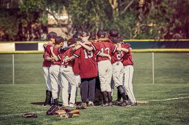 picture of huddle  - Baseball team in a huddle before a game - JPG