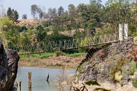 pic of suspension  - above the water between two rocks hangs a suspension bridge - JPG