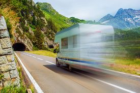 stock photo of recreational vehicle  - Speeding Camper on a Mountain Road - JPG