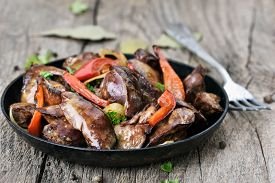 image of liver fry  - Roasted chicken liver with red pepper in a frying pan - JPG