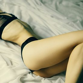 image of masturbate  - Sexy fashion lady in lace underwear in bed - JPG