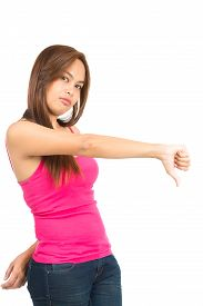 picture of disapproval  - Profile of beautiful smiling Asian female in sleeveless pink tank top gesturing one thumb down expressing disapproval unacceptable bad quality negativity - JPG