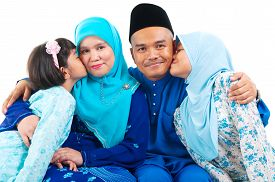 picture of malay  - Malay girls kiss their parent on white background - JPG