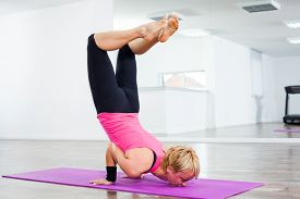 picture of scorpion  - Young woman practicing yoga - JPG