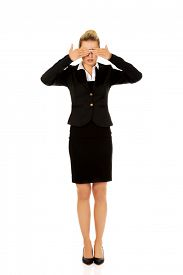 picture of evil  - Beautiful woman covering her eyes with her hands - JPG
