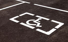 pic of handicapped  - Parking places with handicapped or disabled signs and marking lines on asphalt - JPG