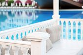 Place for rest near swimming pool in luxury hotel poster