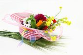 stock photo of leghorn  - Hat and flower bouquet isolated on white background - JPG
