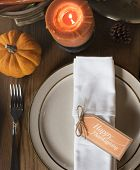 Pumpkin Plate Candle Thanksgiving Table Setting Concept poster