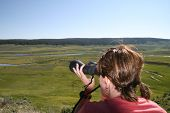 foto of lamar  - Lady with binoculars looking for wildlife at Hayden valley in Yelowstone National park - JPG