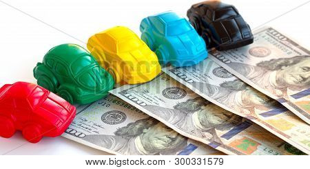 poster of Concept Cars And Money. Little Toy Car Mock-ups And Dollars Banknotes On White Table. Buying, Rentin