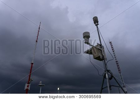 poster of Portable Automatic Weather Station At Ngurah Rai Airport Under The Scary Dark Cumulonimbus Clouds. T