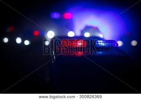 poster of Police Cars At Night. Police Car Chasing A Car At Night With Fog Background. 911 Emergency Response