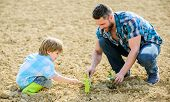 Rich Natural Soil. Eco Farm. New Life. Soils And Fertilizers. Small Boy Child Help Father In Farming poster