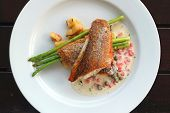 Top View Of Pan Seared Sea Bass With Tomato Caper Mustard Cream Sauce poster