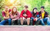 Group Of Young Friends In A Row Holding Mobile Phone Looking Down Smiling - Happy Teenagers On Hikin poster