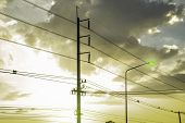 Electricity Pole With Silhouette Sunset Sky, Electricity Pylon With Shadow Of Tree In Dawn Time, Ele poster