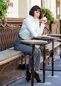 Dessert Concept. Woman Attractive Elegant Brunette Enjoy Dessert And Coffee Cafe Terrace Background. poster