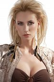 image of youg  - portrait of blond beautiful youg woman with golden earrings with hair style and wearing a shining sequins jacket - JPG