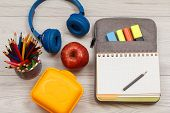 Apple, Metal Stand For Pencils With Color Pencils, Lunch Box, Headphones, Open Exercise Book On Bag- poster