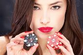 picture of flush  - Close up of a pretty woman holding gambling chips - JPG