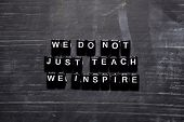 We Dont Just Teach We Inspire On Wooden Blocks. Education, Motivation And Inspiration Concept poster