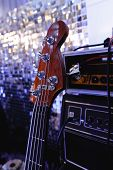 Electric Bass Guitar Stands On The Stage. Close Up. poster