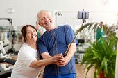 Smiling Elderly Couple Taking Selfie At Gym. Beautiful Senior People Resting In Gym Taking Selfie Wi poster