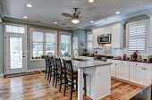 Beautiful kitchen remodel with granite countertops, stainless appliances and hardwood floors. poster