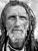 pic of facial piercings  - Eccentric gentleman with facial jewelry in black and white - JPG