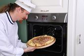 Young Chef Prepared Italian Pizza In Kitchen
