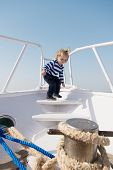 Happy Little Boy On Yacht. Boat Trip By Sea Or Ocean. Funny Kid In Striped Marine Shirt. Yacht Trave poster