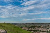 Woman Stands On Horizon Above Theodore Roosevelt National Park poster